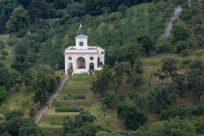 Cute little white church amongst the greenery