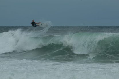 Dan trying to land some airs in the surf