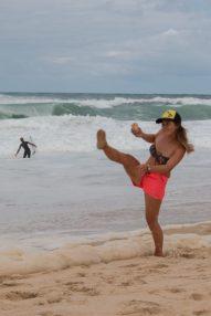 Hannah kicking sand