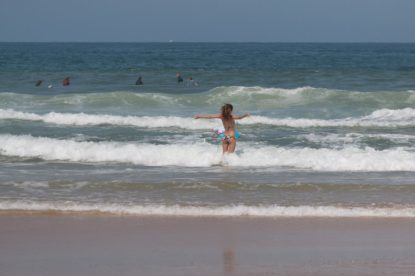 Tegan playing on the waves