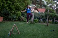 Claudia walking the slack line in the backyard