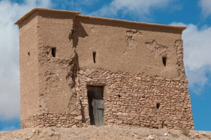 Mud house with a wooden door