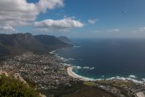 Looking over Camps Bay from Lions Head, houses lining the hills, ocean looking crisp