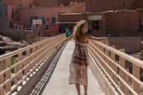 Tegan mid twirl while walking across a bridge