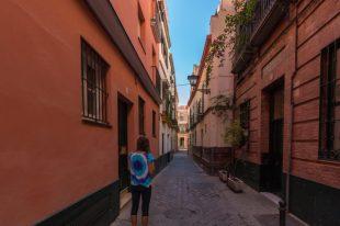 Tegs walking a narrow street