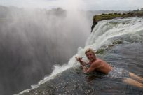 Dan pulling a shaka while hanging over the edge of the falls