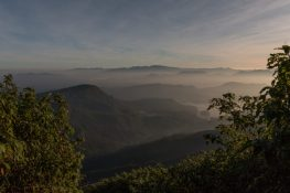 Mist over the mountains as the sun rises