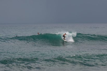 Dan surfing a right