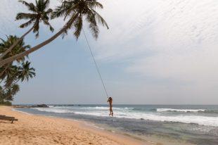 Tegs swinging off a rope swing
