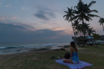 Tegan sitting on her sarong watching the sunset, flower n her hair