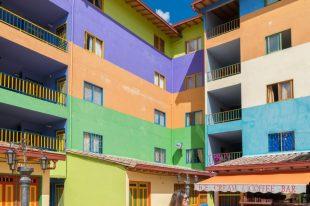 yellow, purple, orange, green striped buildings