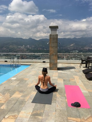Tegan doing yoga on the rooftop