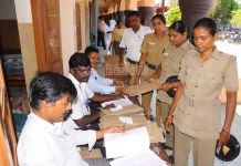 Police personnel cast their votes through postal ballots