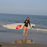 Stand up Paddler withe her inflatable SUP Board at the Baltic Sea