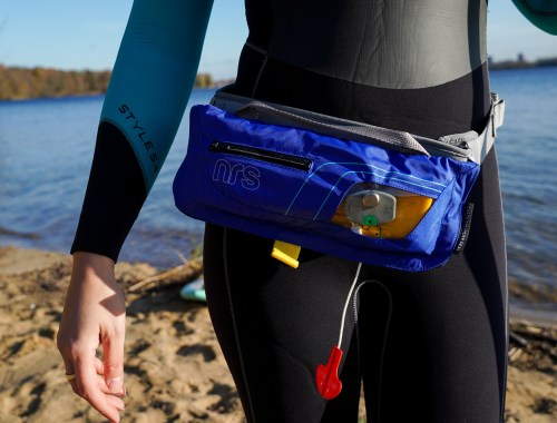 Stand up Paddler wearing a PFD from NRS