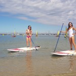 2 woman posing on a paddle board during their private lesson