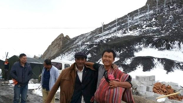 Kong Yuanfeng with a coworker during one of his last jobs as a Xinjiang migrant worker