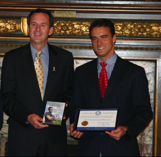 Governor of Minnesota awards Fitness Trainer Michael Gonzalez-Wallace