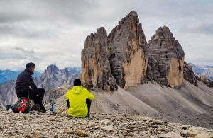 When to hire first employee - superboss hiring - two men in the mountains