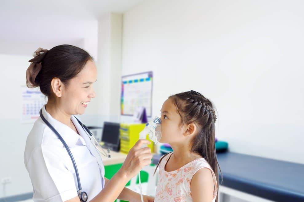 Healthcare professional treating toddler