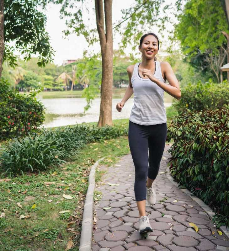 woman jogging in her driveway