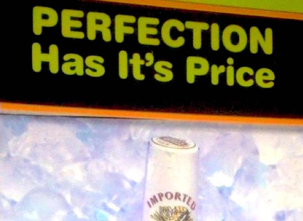 "Image showing a portion of the Stella Artois ad; you can see a little bit of the top of a bottle of beer, and above it is a headline that says, ""PERFECTION Has It's Price,"" with an apostrophe in the word ""It's."""