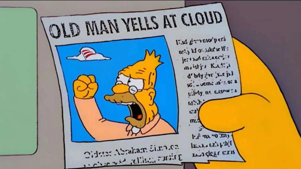 """Image from """"The Simpsons"""" TV show, showing someone holding a newspaper with a photo of Grandpa Simpson holding his fist in the air at a cloud in the blue sky, and the headline over that photo reads, """"OLD MAN YELLS AT CLOUD."""""""