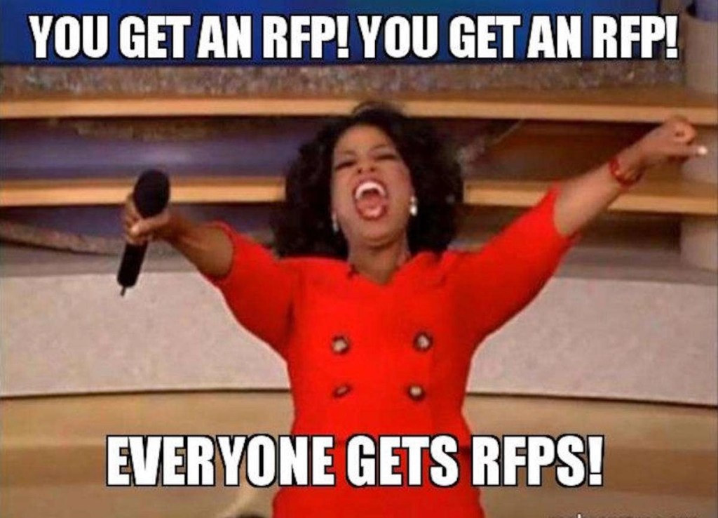 """Meme image showing an old photo of Oprah Winfrey from her talk show days, wearing a bright red dress, holding a microphone in one hand, both arms held high into the air, her mouth open as if she's screaming to her audience. And the text overlaid on this meme image says the following: """"You get an RFP! You get an RFP! EVERYONE gets RFPs!"""""""