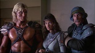 Dolph Lundgren as He-Man, Chelsea Field as Teela, and Jon Cypher as Man-At-Arms.
