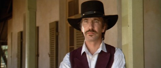 Alan Rickman may be dead, but he will always be able to wear cowboy hats better than you ever will.