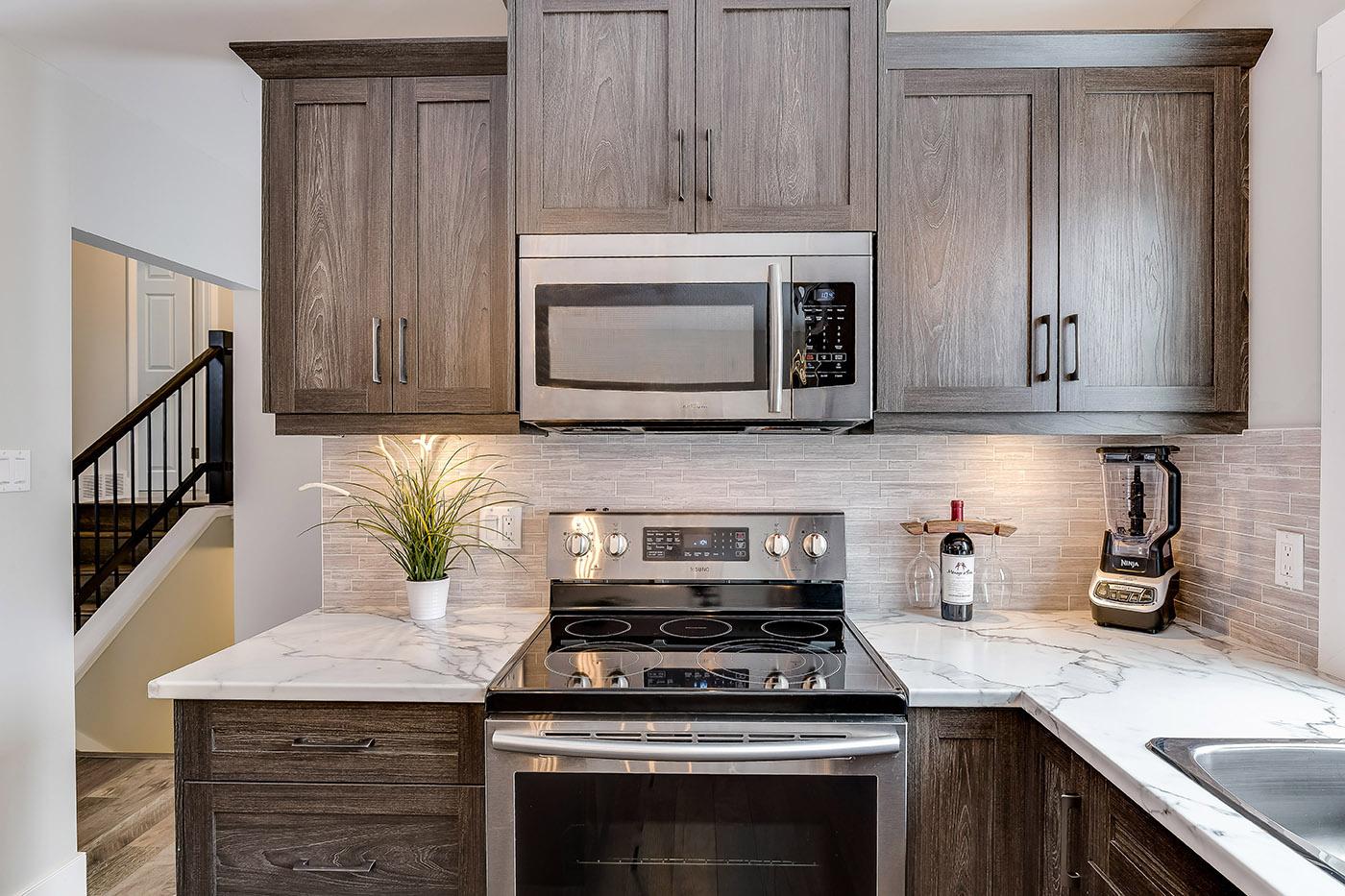 valances for kitchen pendant lighting under cabinet concealment options superior cabinets dark melamine by finish name silva