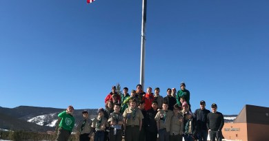 Troop in front of American flag