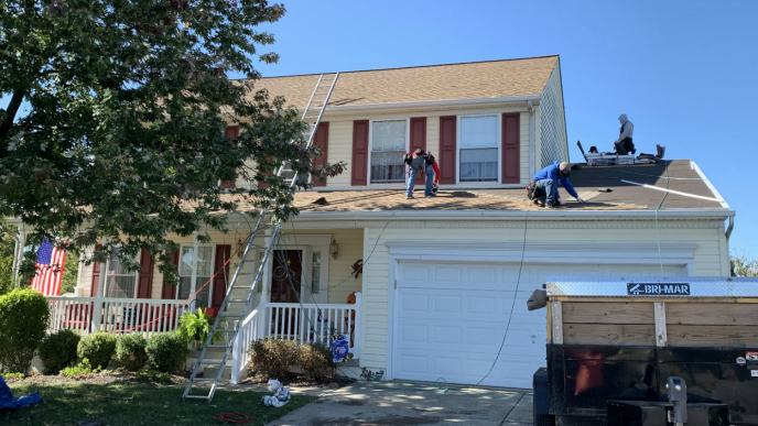 Roof repair in Manchester MD 21088 by Superior Services roofing contractors. We also installed custom metal fascia and counter-flashing with this roofing system.