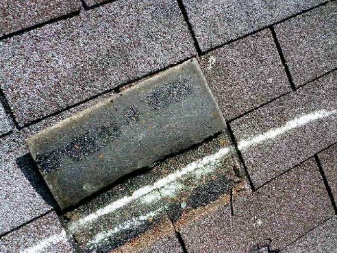 Another shingle with wind damage from a recent hail storm in Westminster MD. We got this roof approved for a full replacement by insurance.