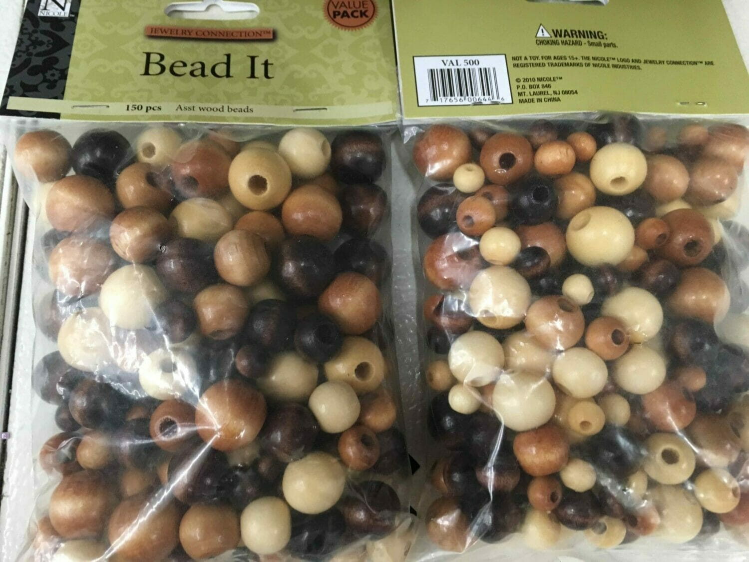 Bags of assorted wooden beads cover a