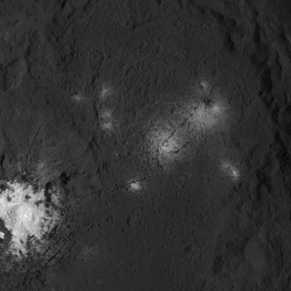 Closeup of the bright spots in Occator crater. They're thought to be salts, either MgSO₄•6H₂O or Na₂CO₃, and may have been created by hydrothermal activity.