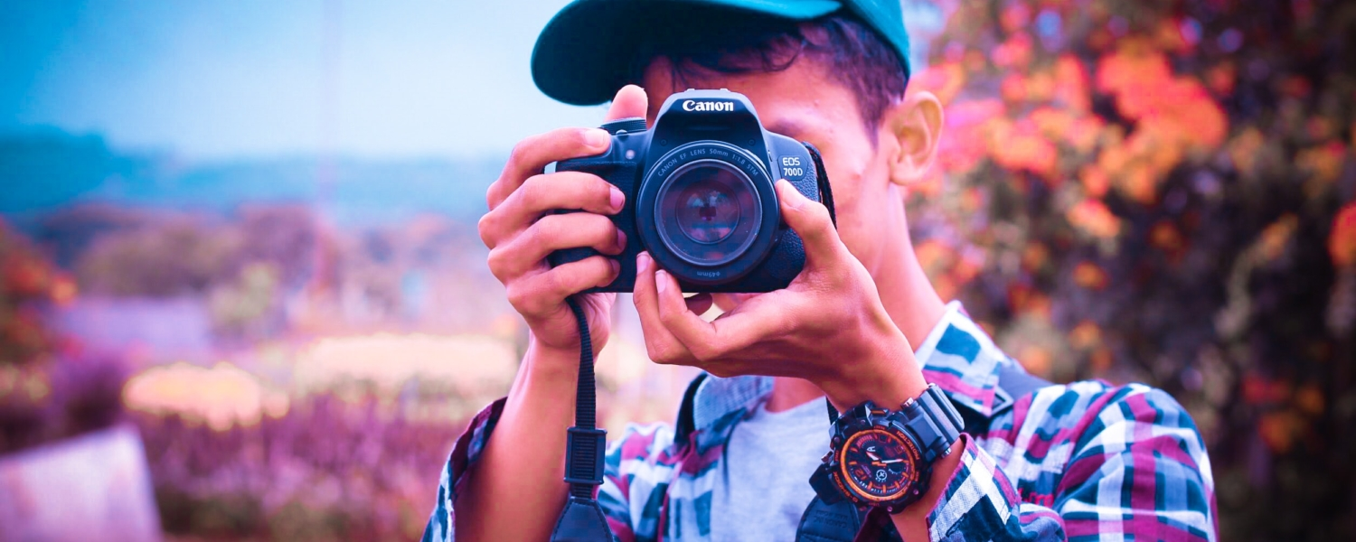 shallow-focus-photography-of-a-man-holding-camera-1078810