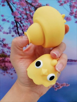 Image: Me holding a beheaded Emojibator Chickie and sticking about a centimeter of my thumb in the suction nozzle to show its depth