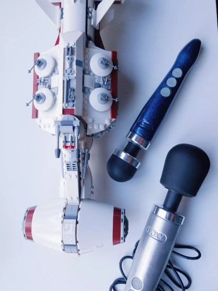 [Image: silver Doxy Die Cast and small blue sparkle Doxy 3 Rechargeable die cast wands]