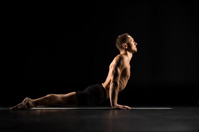 Cobra Pose on yoga mat.. Flexibility and Core Training. Balance.
