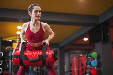 Bent over row. Sandbag workout. Functional fitness. Full Body Workouts. Sandbag back exercises