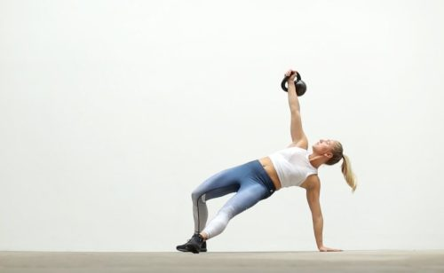 Kettlebell exercises. Turkish Get up. TGU. Kettlebells. Functional fitness.