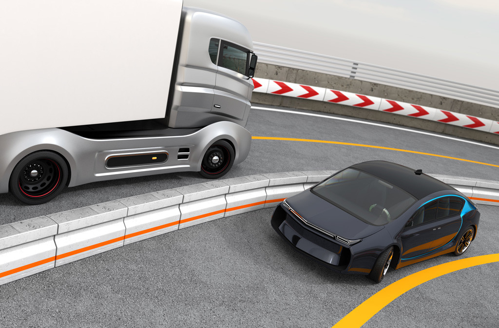 Hybrid electric truck and white electric car on highway