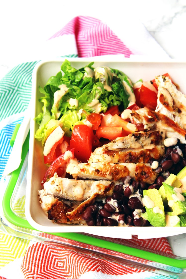 Chicken and Avocado Salad with protein rich black beans and a smokey buttermilk dressing. Healthy eating doesn't get better than this. Find the recipe at Supper in the Suburbs