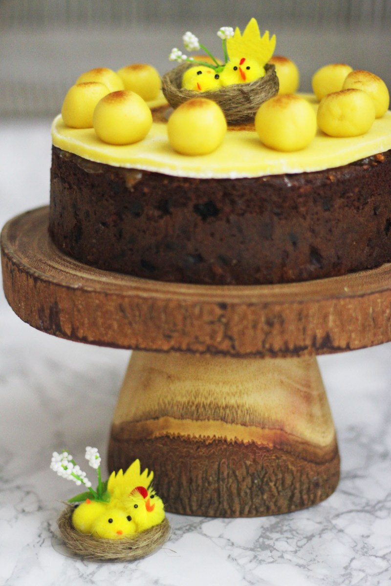 Simnel Cake is a traditional fruit cake topped with marzipan and served at Easter find the recipe on Supper in the Suburbs