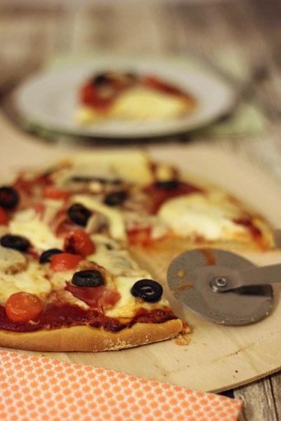 Homemade prosciutto and olive pizza