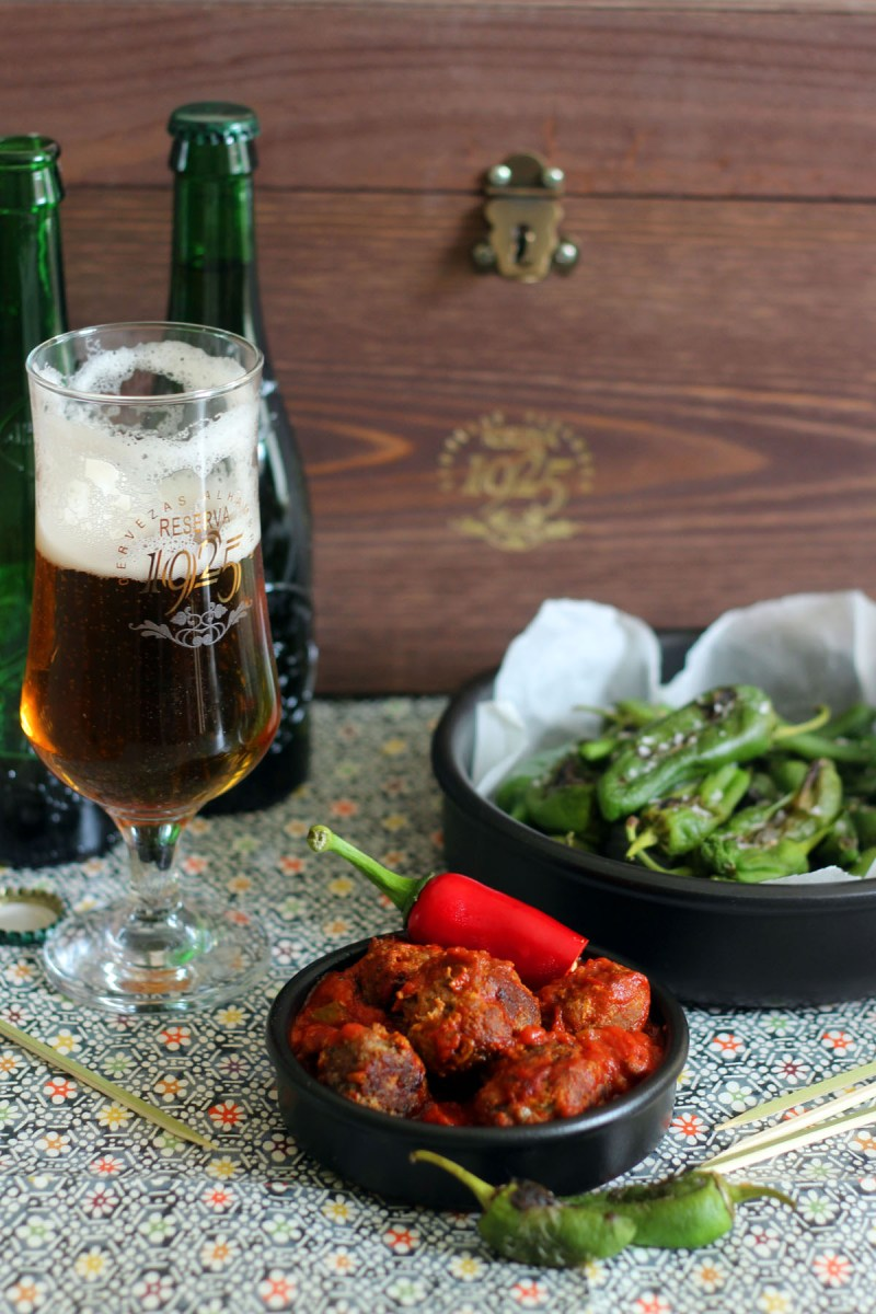 Chorizo Meatballs and padron peppers served with Alhambra Reserva 1925