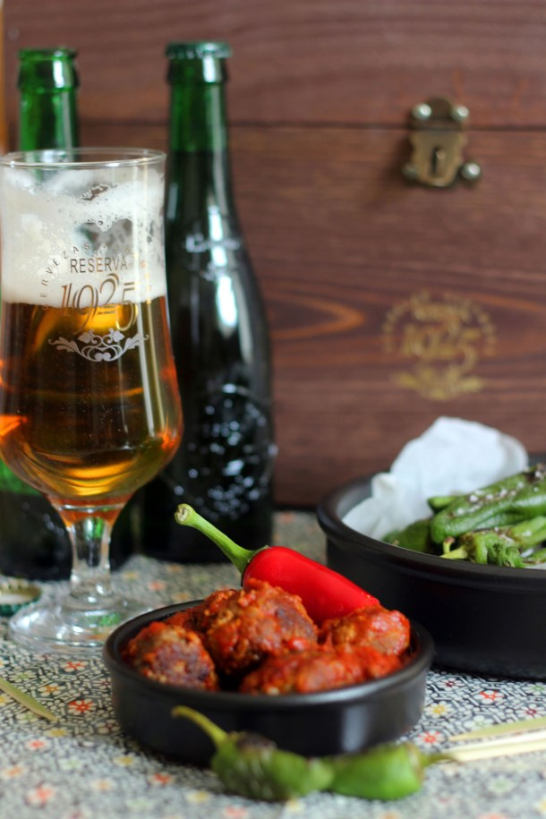 Chorizo Meatballs with Padron Peppers served with Alhambra Reserva 1925