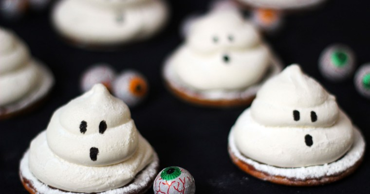 Terrifying Teacakes – chocolate biscuits topped with jam and marshmallow ghosts