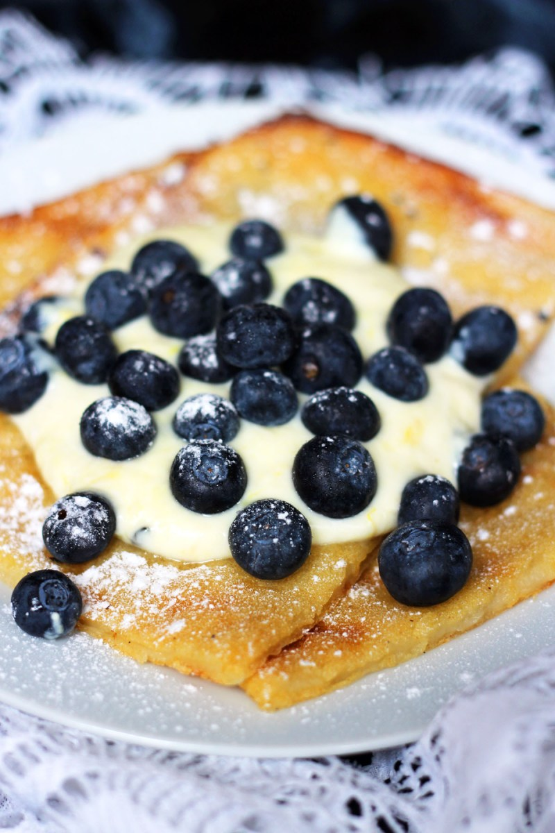 Oven Baked Pancakes are a traditional Scandinavian dish best served with yogurt and fresh blueberries